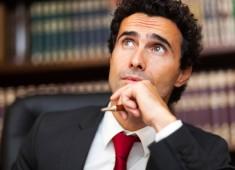 Confident businessman thinking at a problem