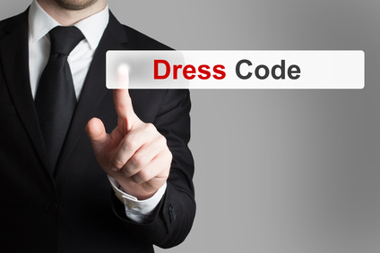 photo : businessman pushing button dress code
