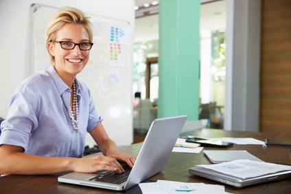 photo : Portrait Of Businesswoman Working In Creative Office