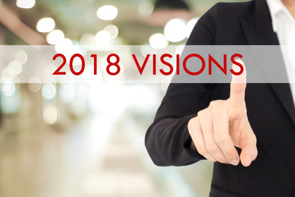 photo : Businesswoman hand touching 2018 visions button over blur office background, banner with copy space, annual plan for success in business concept