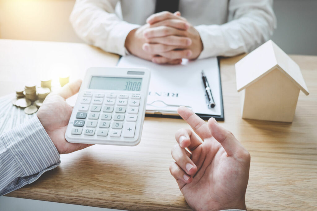 photo : Business Signing and analyzing a contract buy - sell house, insurance agent analyzing cost about home investment loan Real Estate, Concept mortgage loan approval